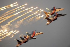 Russian Air Force Russkiye Vityazi team on their Sukhoi Su-27 jet fighters perform during a demonstration flight at the Moscow International Air Show (MAKS) in Zhukovsky