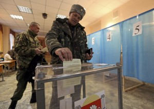 A Cossak casts his ballot during the referendum on the status of Ukraine's Crimea region at a polling station in Simferopol